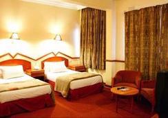 New Ambassador Hotel - ハラレ - 寝室
