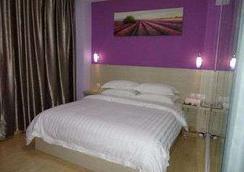 Super 8 Hotel Quanzhou Creative Park - Quanzhou - 寝室