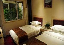 Super 8 Hotel Beijing Bei Hai Park West Gate - 北京市 - 寝室