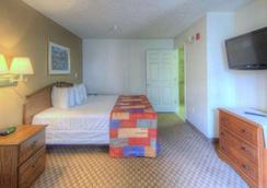 Intown Suites Orlando/Florida Turnpike - オーランド - 寝室