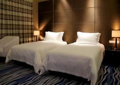 Brigh Radiance Hotel - Yantai - 寝室