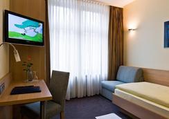 シティ パートナー ホテル ベルリナー ホフ - カールスルーエ - 寝室