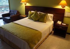 Casa Morales Hotel Internacional y Centro de Convenciones - Ibague - 寝室