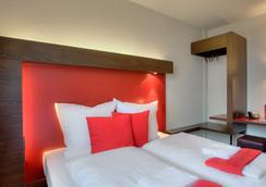 マイニンガー ホテル ベルリン ハウプトバーンホフ - ベルリン - 寝室