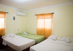 Tropical Island Aparthotel - サントドミンゴ - 寝室