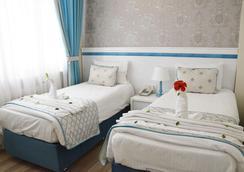 スター ホリデイ ホテル - イスタンブール - 寝室