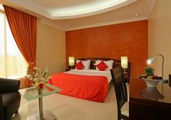 The Royale Gardens Hotel - Alappuzha - 寝室