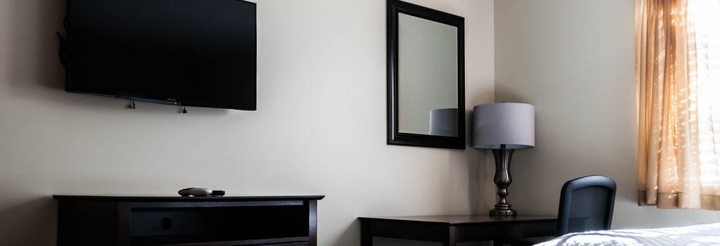Holmesuites Inn - コロンバス - 寝室
