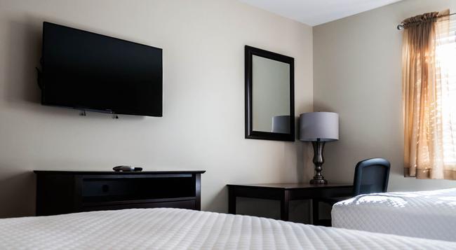 Holmes Suites & Inn - コロンバス - 寝室