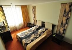 ホテル ユビレイニー - ミンスク - 寝室