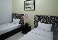 Ar-raudhah Suite & Hotel - George Town - 寝室