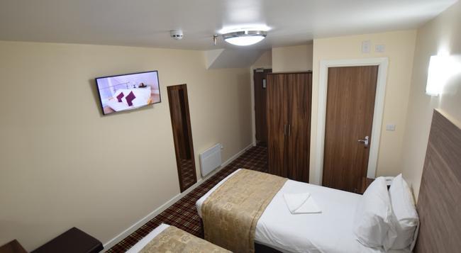 ラッキー 8 ホテル - イルフォード - 寝室