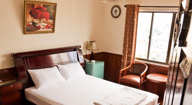 Tan Hoang Mai Hotel - ホーチミン - 寝室