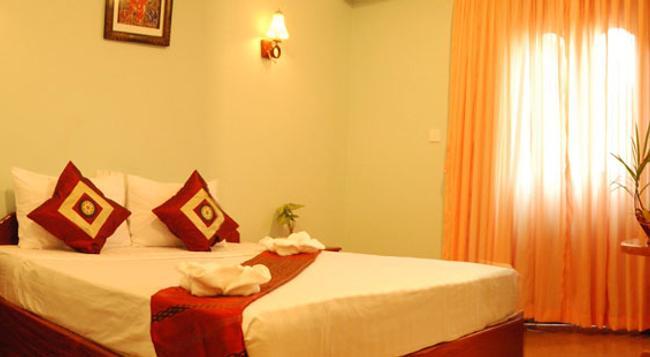 Rithy Rine Angkor Hotel - シェムリアップ - 寝室