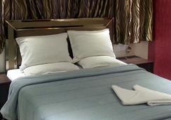 Hotel Kamran Residency - ムンバイ - 寝室