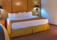 ホテル グアダラハラ プラザ エヘクティボ ロペス マテオス - グアダラハラ - 寝室