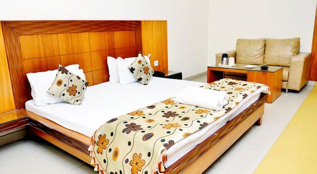 Hotel Mandakini Plaza, Kanpur - Kanpur - 寝室