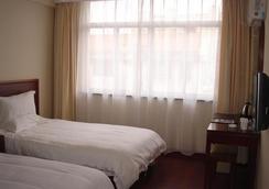 Greentree Inn Jiangsu Nantong Tongzhou Bus Station Express Hotel - Nantong - 寝室