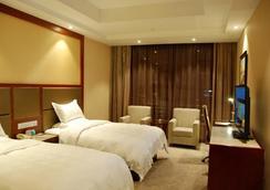 GreenTree Eastern Quzhou Hewu Road Hotel - Quzhou - 寝室