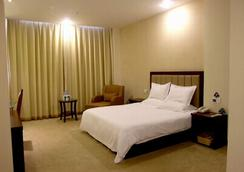 Greentree Inn Yancheng Station Hotel - Yancheng - 寝室