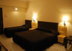 Hotel Millennium - Guwahati - 寝室