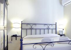 Hotel Domominore - アルゲーロ - 寝室