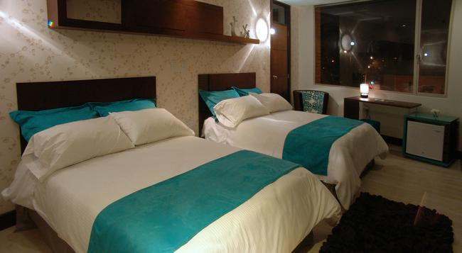 Rioné Hotel Boutique - クエンカ - 寝室