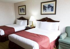 GuestHouse Inn & Suites Sioux Falls - スーフォールズ - 寝室