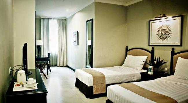 Puri Denpasar Hotel - 南ジャカルタ市 - 寝室