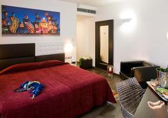 エコホテル ローマ - ローマ - 寝室