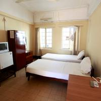 New Palm Tree Hotel Twin bed room