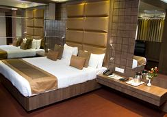 Hotel Centre Point - Nagpur - 寝室
