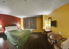 Americas Best Value Inn & Suites - Longview - 寝室