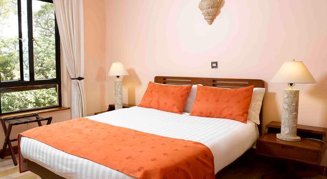 Wasini Luxury Suites - ナイロビ - 寝室