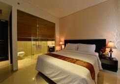 エミリア ホテル バイ アメイジング - パレンバン - 寝室