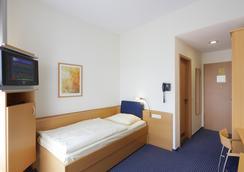 デザインホテル+コングレスセントラム ヴィーネッケ XI. - ハノーファー - 寝室