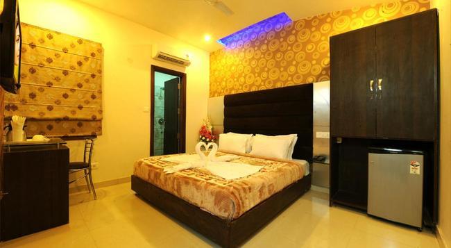 Hotel Pearl Inn & Suites - アムリトサル - 寝室