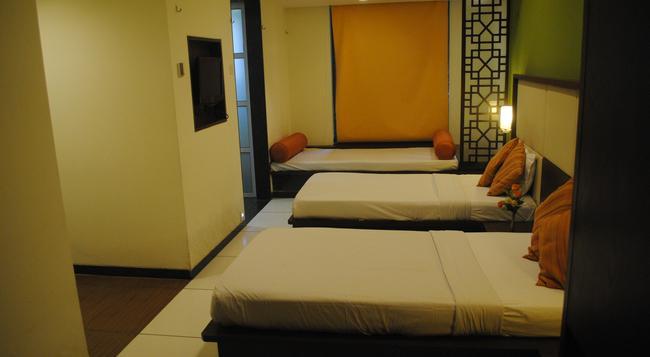 GCC Hotel & Club - ムンバイ - 寝室