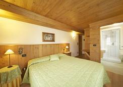 ホテル デンテ デル ジガンテ - クールマイユール - 寝室