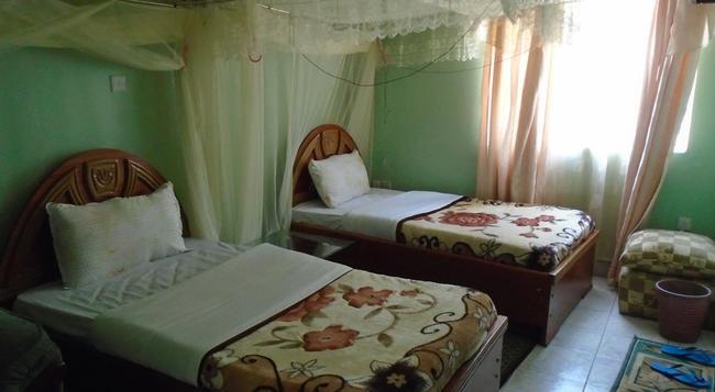 The Pebble Hotel Nairobi - ナイロビ - 寝室