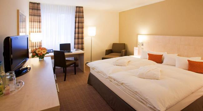 Novum Select Hotel Mainz - マインツ - 寝室