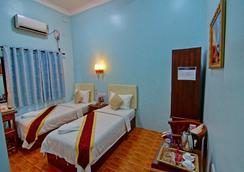 79 リビング ホテル - Mandalay - 寝室