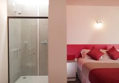 コンセプト デザイン ホステル & スイーツ - フォス・ド・イグアス - 寝室