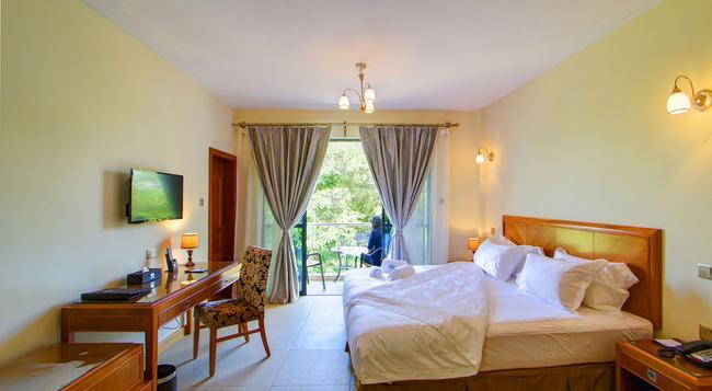 Lotos Inn & Suites - ナイロビ - 寝室