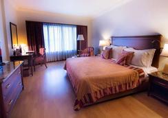 ジ オーキッド アン エコテル ホテル - ムンバイ - 寝室