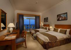 アタナ カサブ ホテル - ハサブ - 寝室