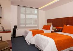 ホテル フィンランディア - キト - 寝室