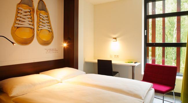 7THINGS Hotel - ブレーメン - 寝室