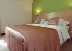 シティ ホテル - ポドゴリツァ - 寝室