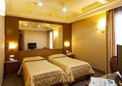 マディソン ホテル - ローマ - 寝室